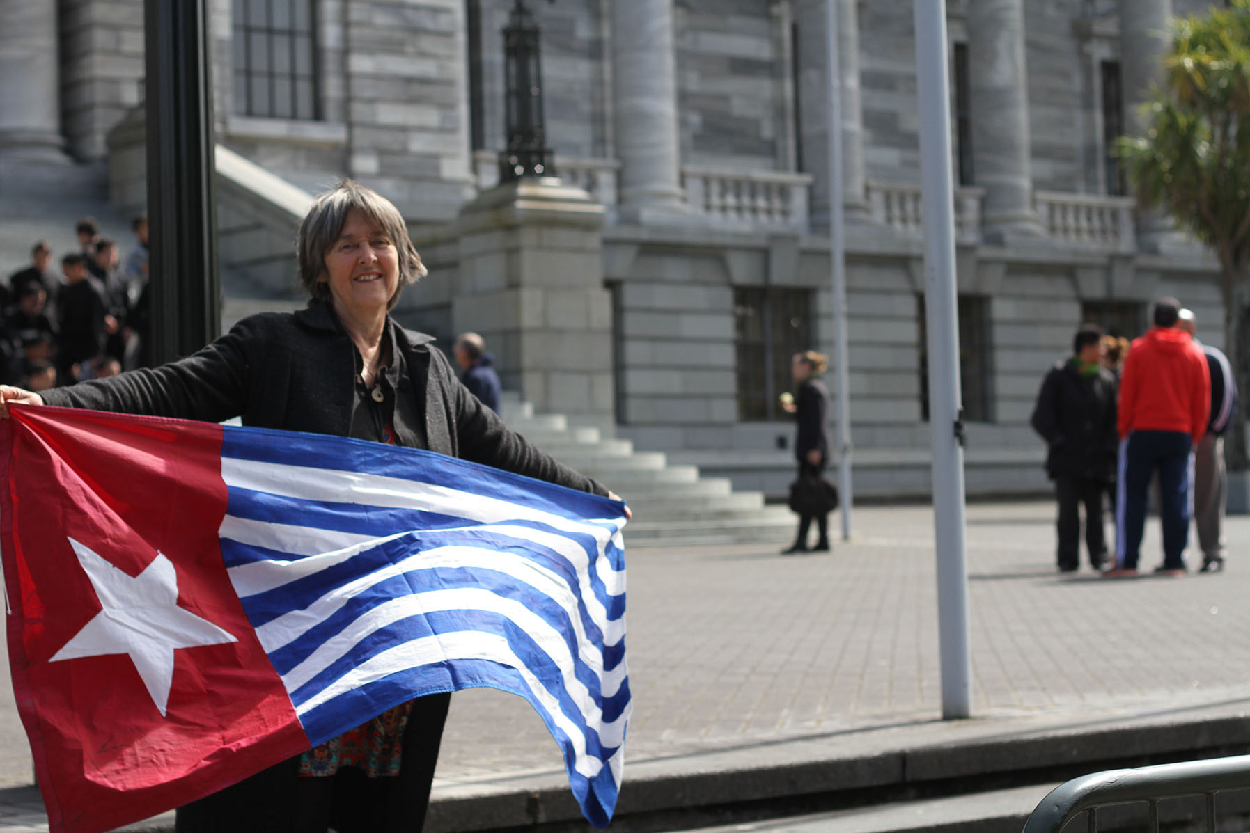 Catherine-Delahunty-with-West-Papua-flag-the-Morning-Star